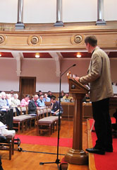 A representative addressing General Synod