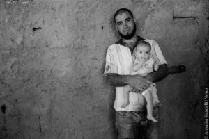 A refugee father with his child